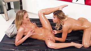 Oiled lesbians enjoying oral one on one