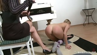 Piano bus punishes her student and fucks her with a stitch on dildo