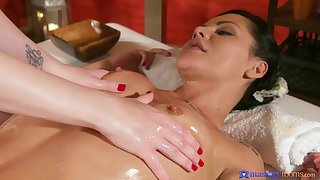 Amazing girl on girl rub-down therapy with a finger fucking.
