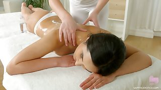 Several bodily babes are wipe the floor with and eating each others pussies on the massage table