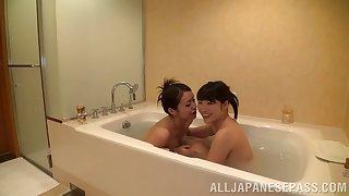 Salacious lesbian girls make out erotically at hammer away bath till they orgasm
