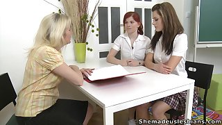 Two naughty coeds are toying every others pussies with respect to front of lesbian teacher