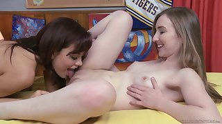 Cheerleaders Sabina Rouge and Gracie May Green pleasure each other